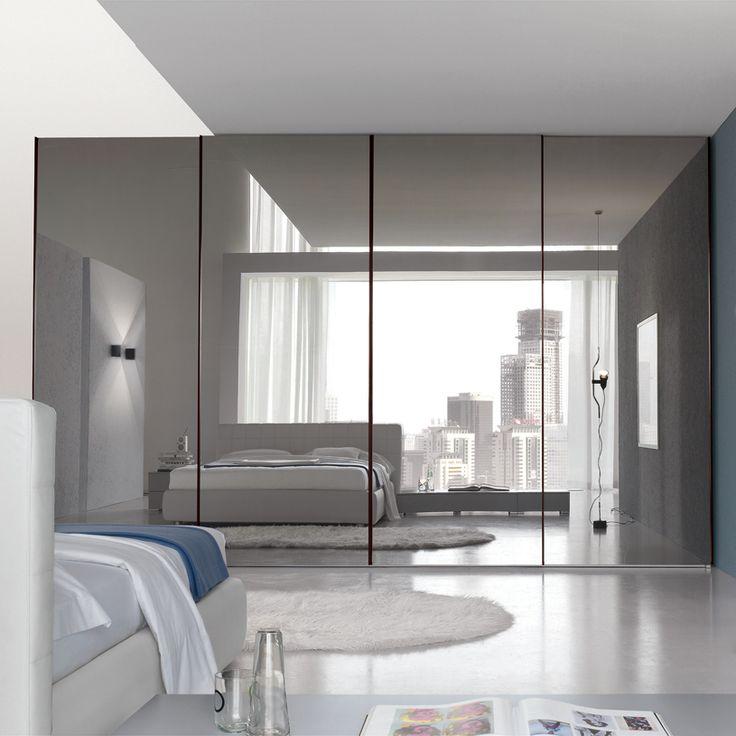 Зеркальные шкафы купе в интерьере спальни фото