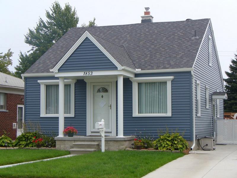 дом из синего сайдинга фото него